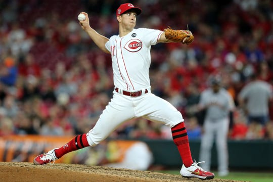 Cincinnati Reds relief pitcher Michael Lorenzen (21) delivers in the eighth inning during an MLB baseball game against the San Francisco Giants, Friday, May 3, 2019, at Great American Ball Park in Cincinnati.