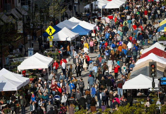 Thousands flocked to downtown Des Moines for the opening day of the Downtown Farmers' Market in on Saturday, May 4, 2019.