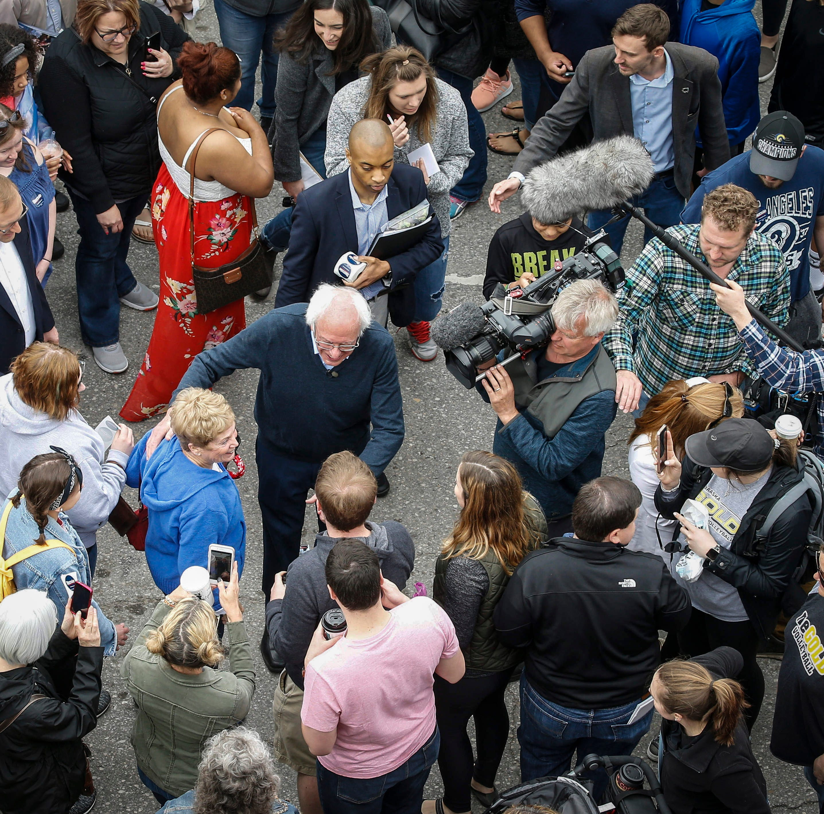 'We love you in Iowa': Crowds flock to Bernie Sanders during surprise visit to Des Moines' Downtown Farmers' Market
