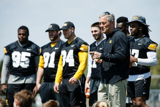 Coach Kirk Ferentz talks to campers after wrapping up a spring camp on Saturday, May 4, 2019, in Johnston.