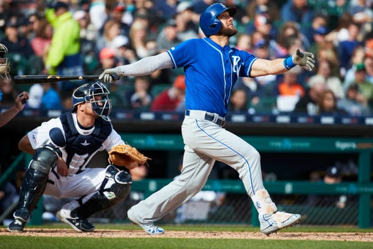 Royals left fielder Alex Gordon hits a sacrifice fly in the fifth inning.