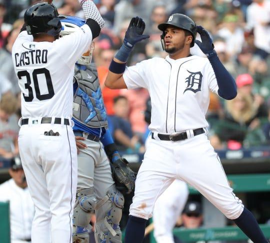 Jeimer Candelario, right, celebrates his home run with Harold Castro on Saturday.