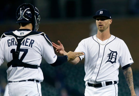 Tigers closer Shane Greene celebrates with catcher Grayson Greiner after the Tigers' 4-3 win over the Royals on Friday, May 3, 2019, at Comerica Park.
