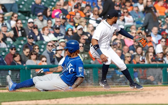 Royals' Adalberto Mondesi, left, reaches third base as Tigers third baseman Jeimer Candelario waits on the throw during the fifth inning Saturday.