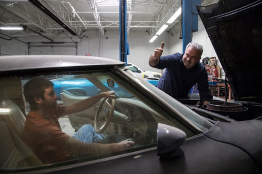 Robert VanOrden of Livonia, Michigan, right, and his son Robert VanOrden Jr., also of Livonia, try to start a 1978 Corvette at My Mechanics Place in Livonia, Saturday, May 4, 2019.