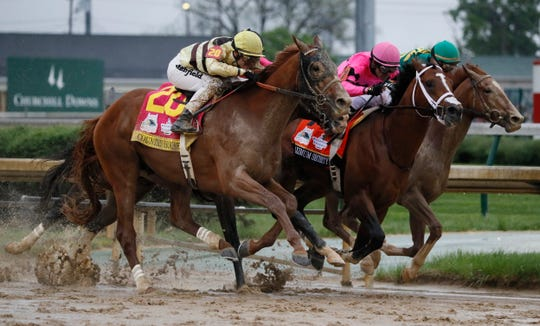 Luis Saez riding Maximum Security, center, crosses the finish line first ahead of Country House, left, and jockey Flavien Prat, during the 145th running of the Kentucky Derby horse race at Churchill Downs, Saturday, May 4, 2019, in Louisville, Ky. Country House was declared the winner after Maximum Security was disqualified following a review by race stewards.