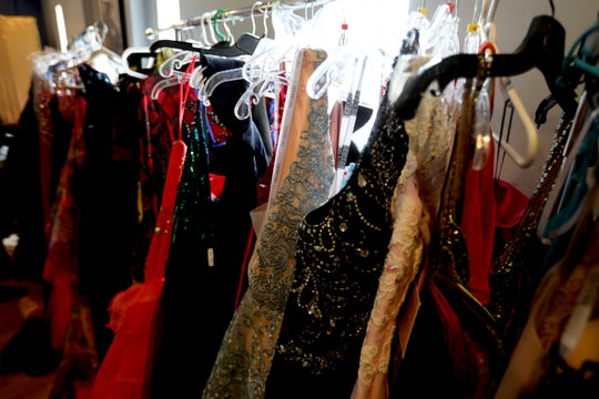 Over 90 new and gently used prom dresses were on display for high schoolers to try on and pick out for their high school proms during the first annual Prom Dress Giveaway at Superbad Boxing Gym in Detroit on Saturday, May 4, 2019.