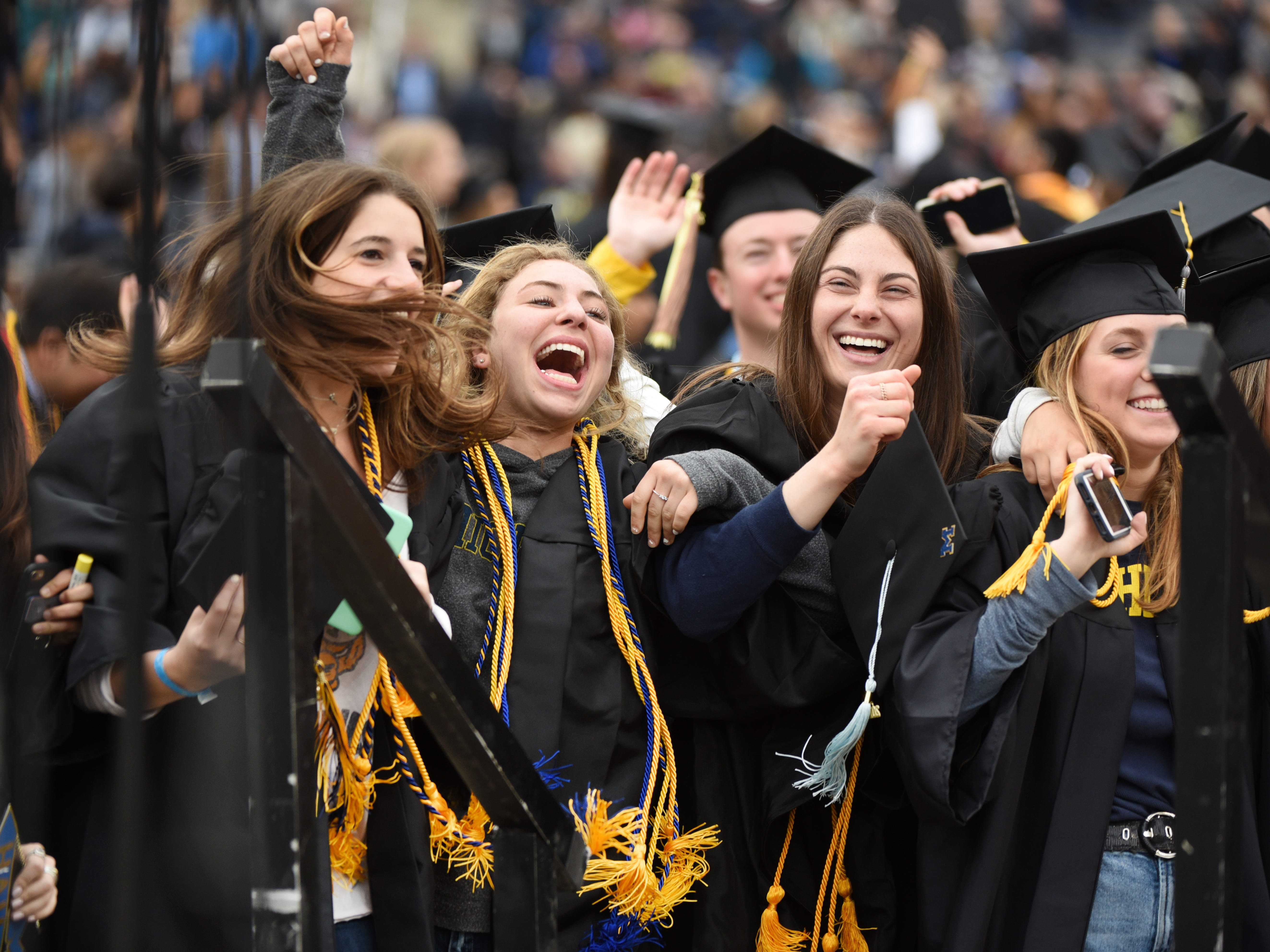 University of Michigan students celebrate during commencement exercises.