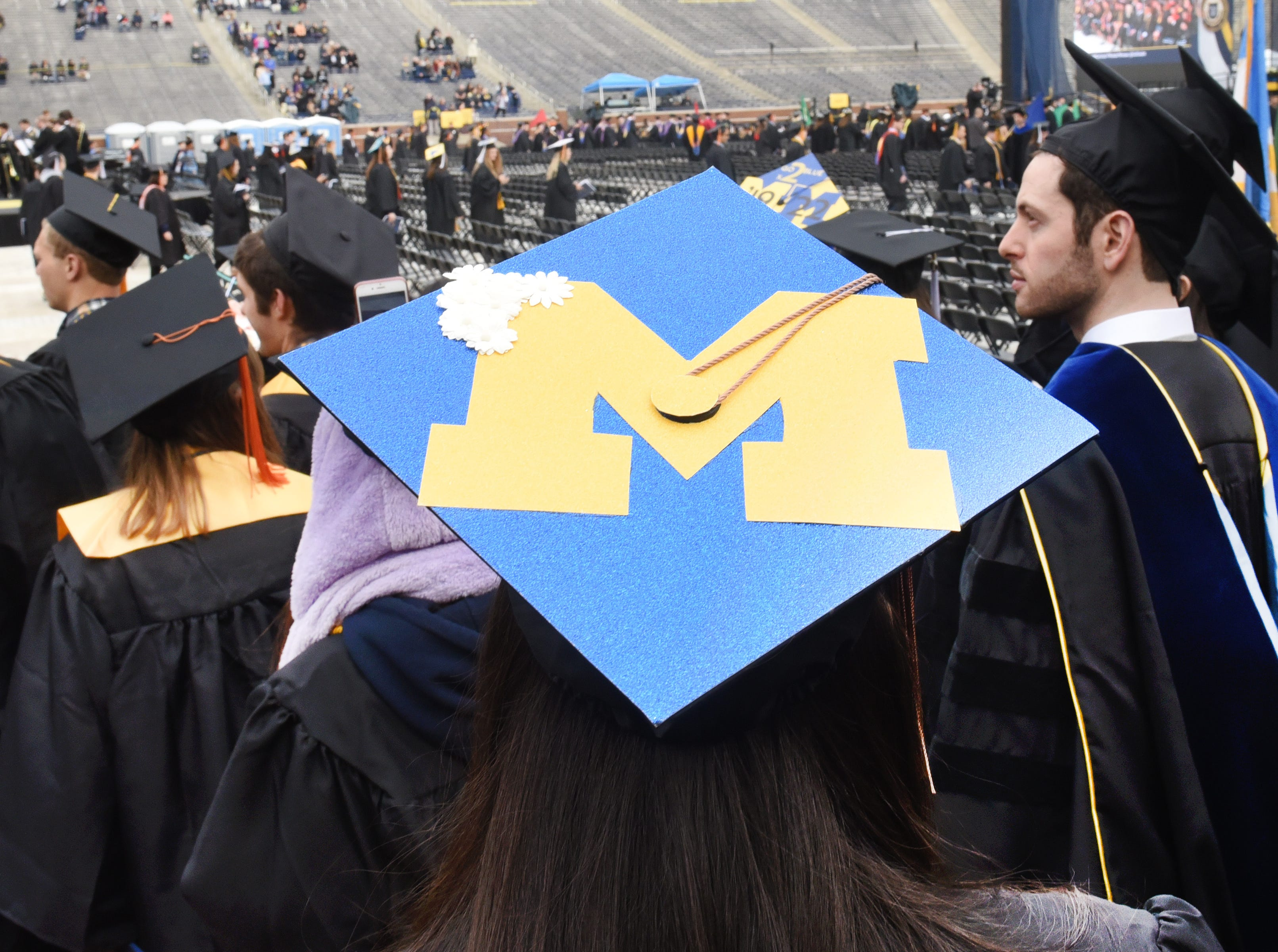 University of Michigan students decorated their mortarboard's for commencement exercises.