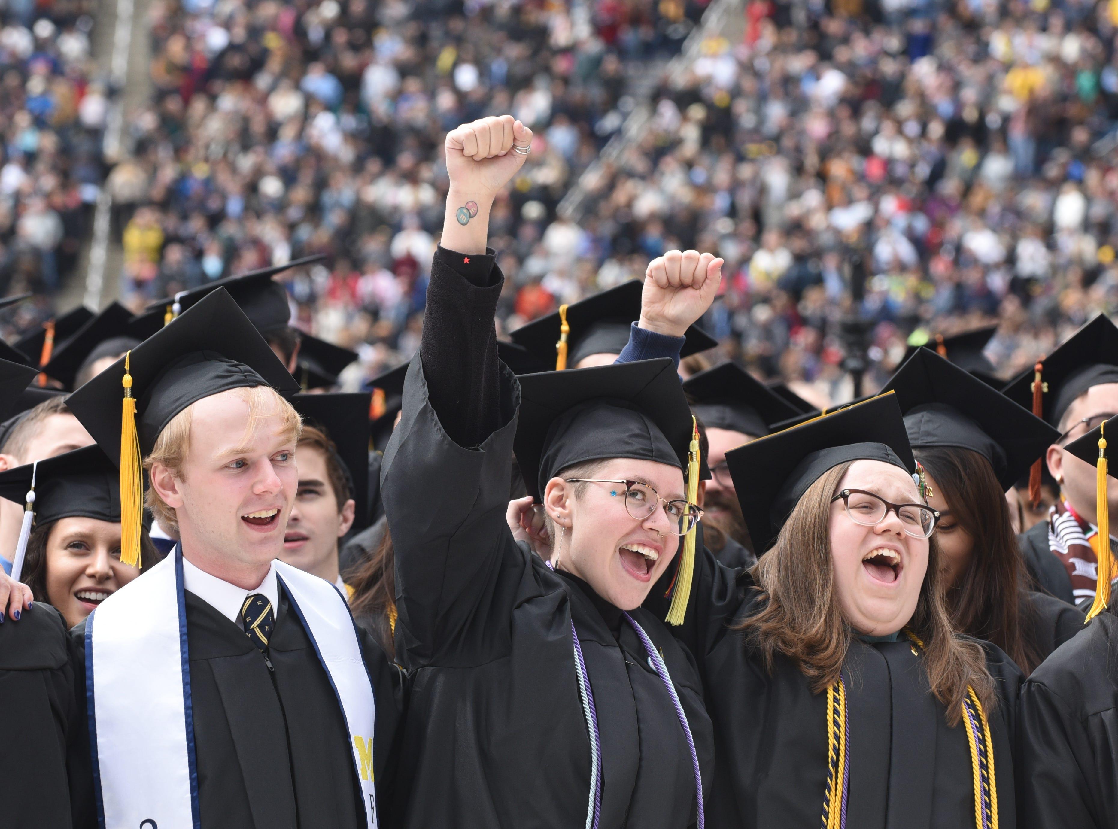 University of Michigan graduate Audra Christophersen (center) shouts 'go blue'.