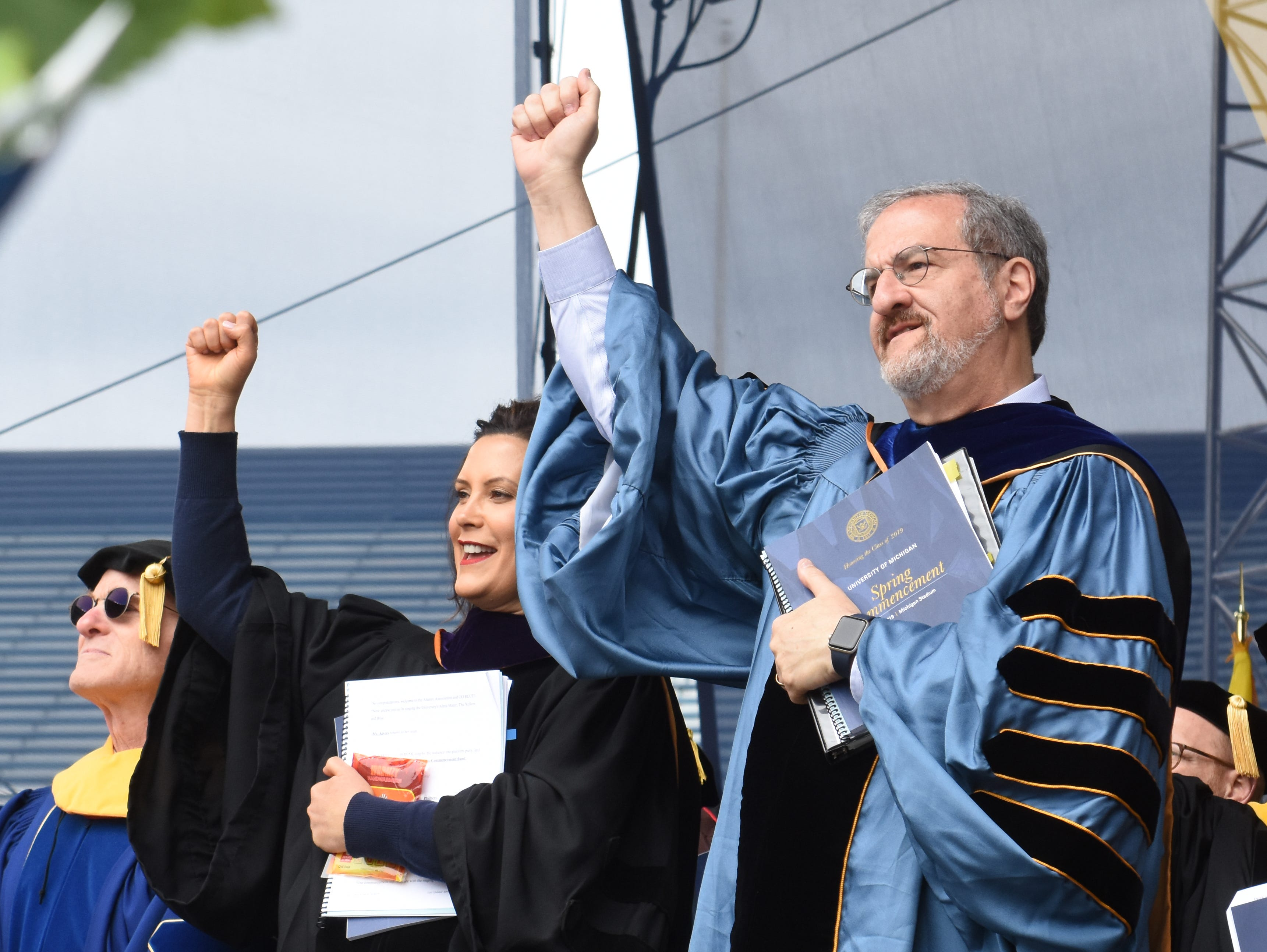 University of Michigan's President Mark Schlissel and Governor Gretchen Whitmer cheer to the UM fight song.