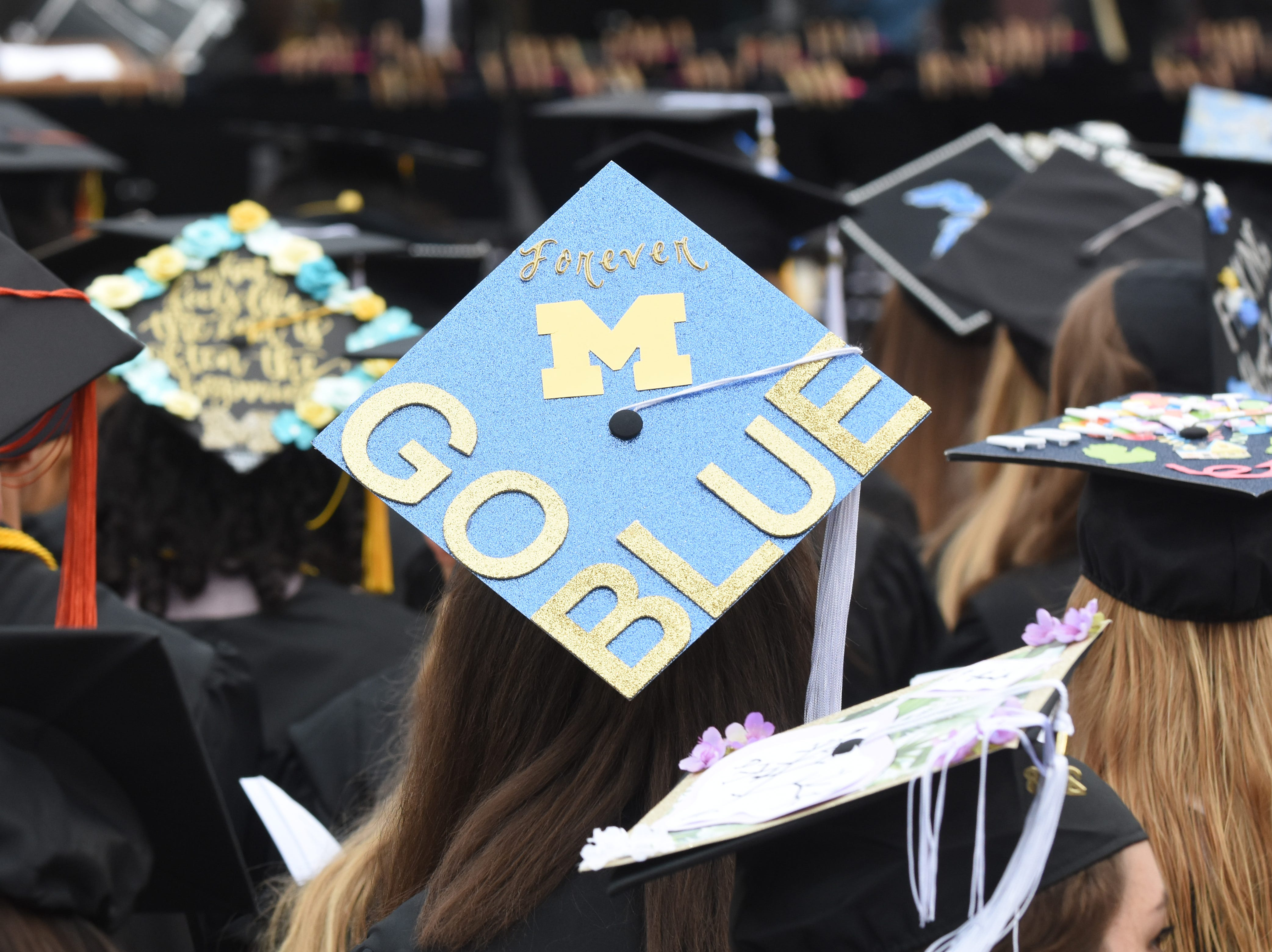 University of Michigan students decorated their mortarboard with plenty of 'go blue'.