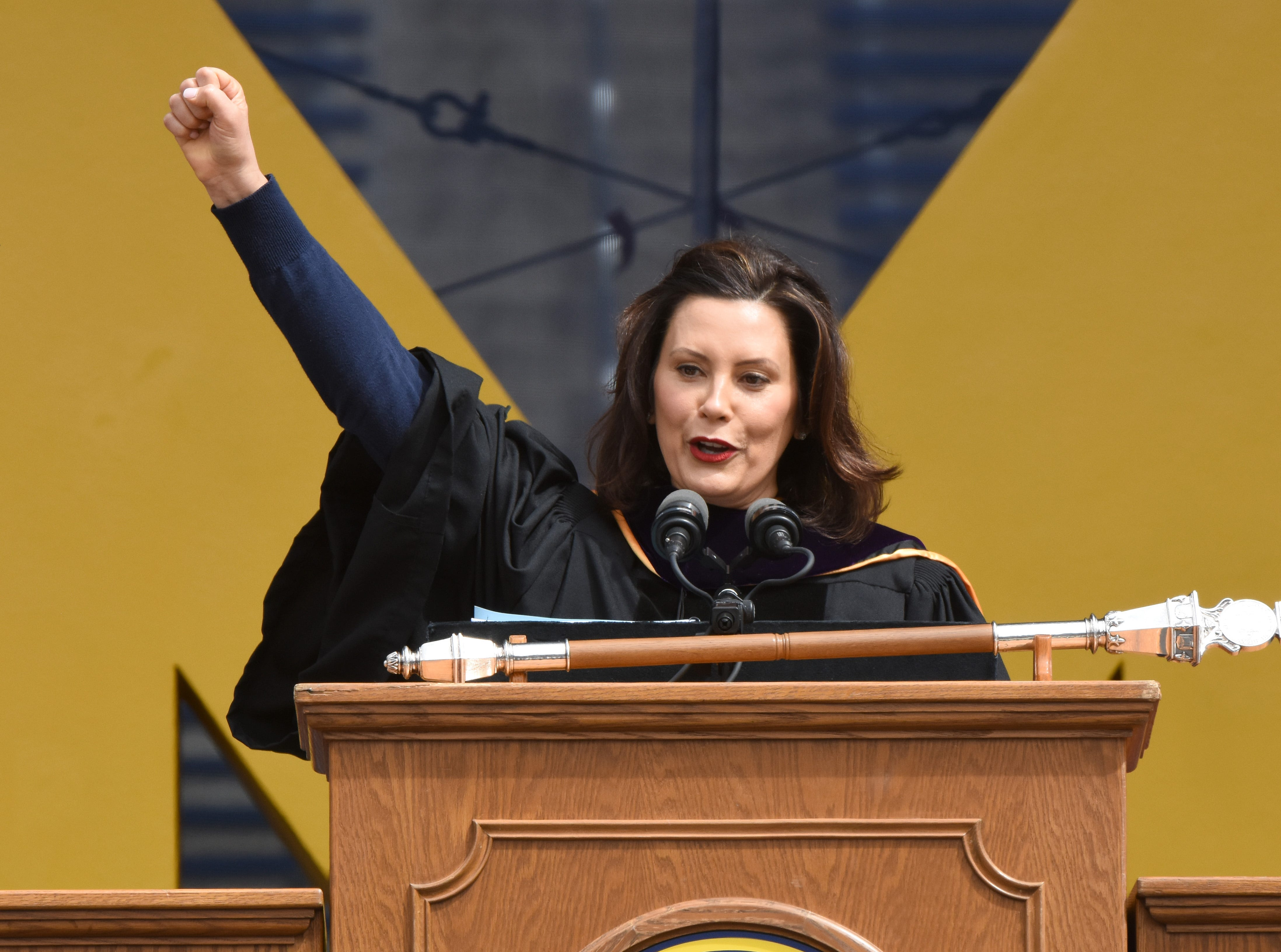 """Governor Gretchen Whitmer shouts 'go blue"""" during her commencement address at the University of Michigan."""