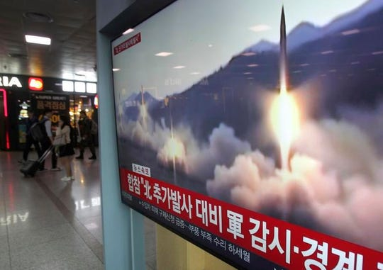 A TV shows file footage of North Korea's missile launch during a news program at the Seoul Railway Station in Seoul, South Korea, Saturday, May 4, 2019.