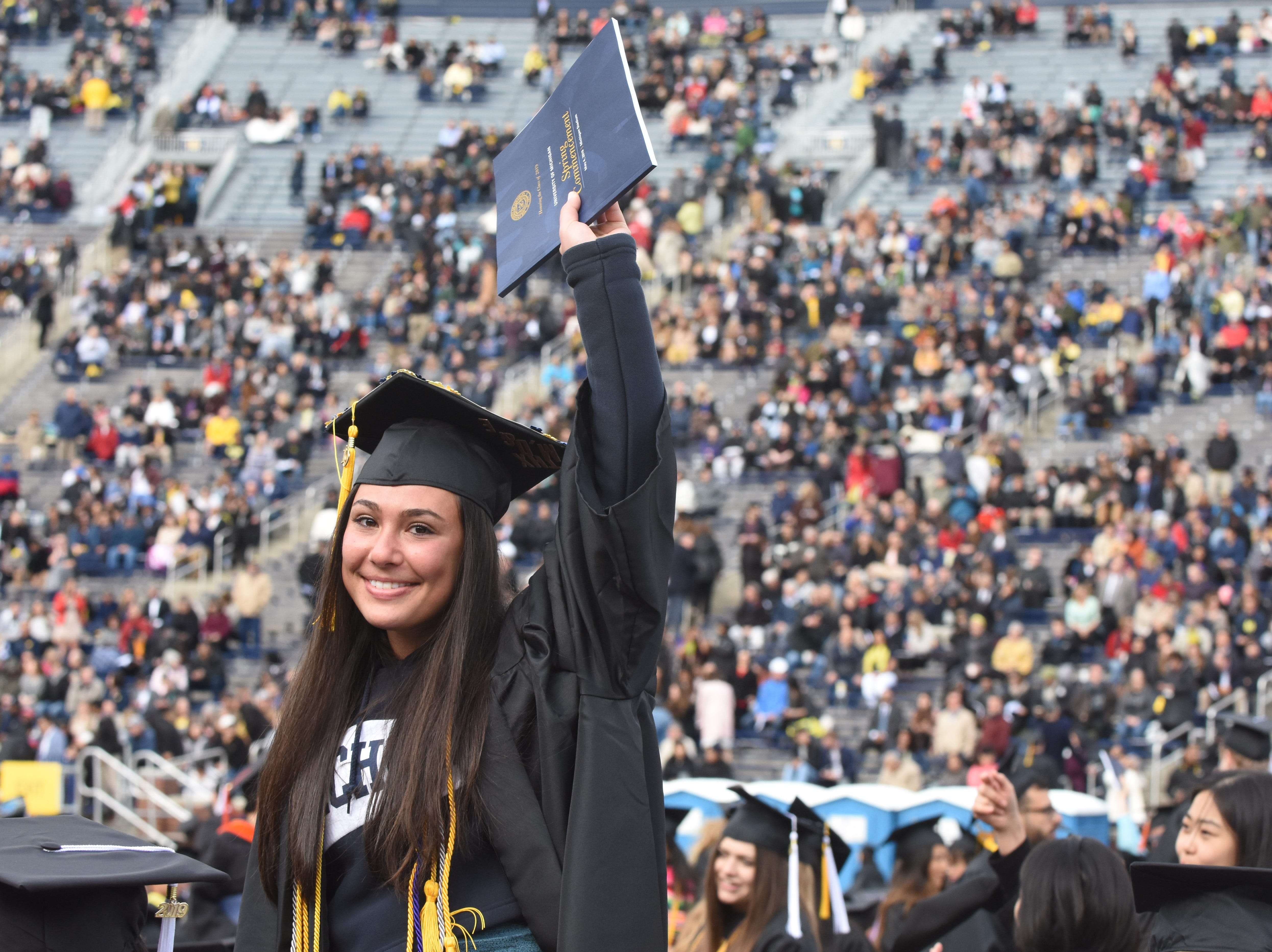 University of Michigan student Allie Poles waves to her friends and family.