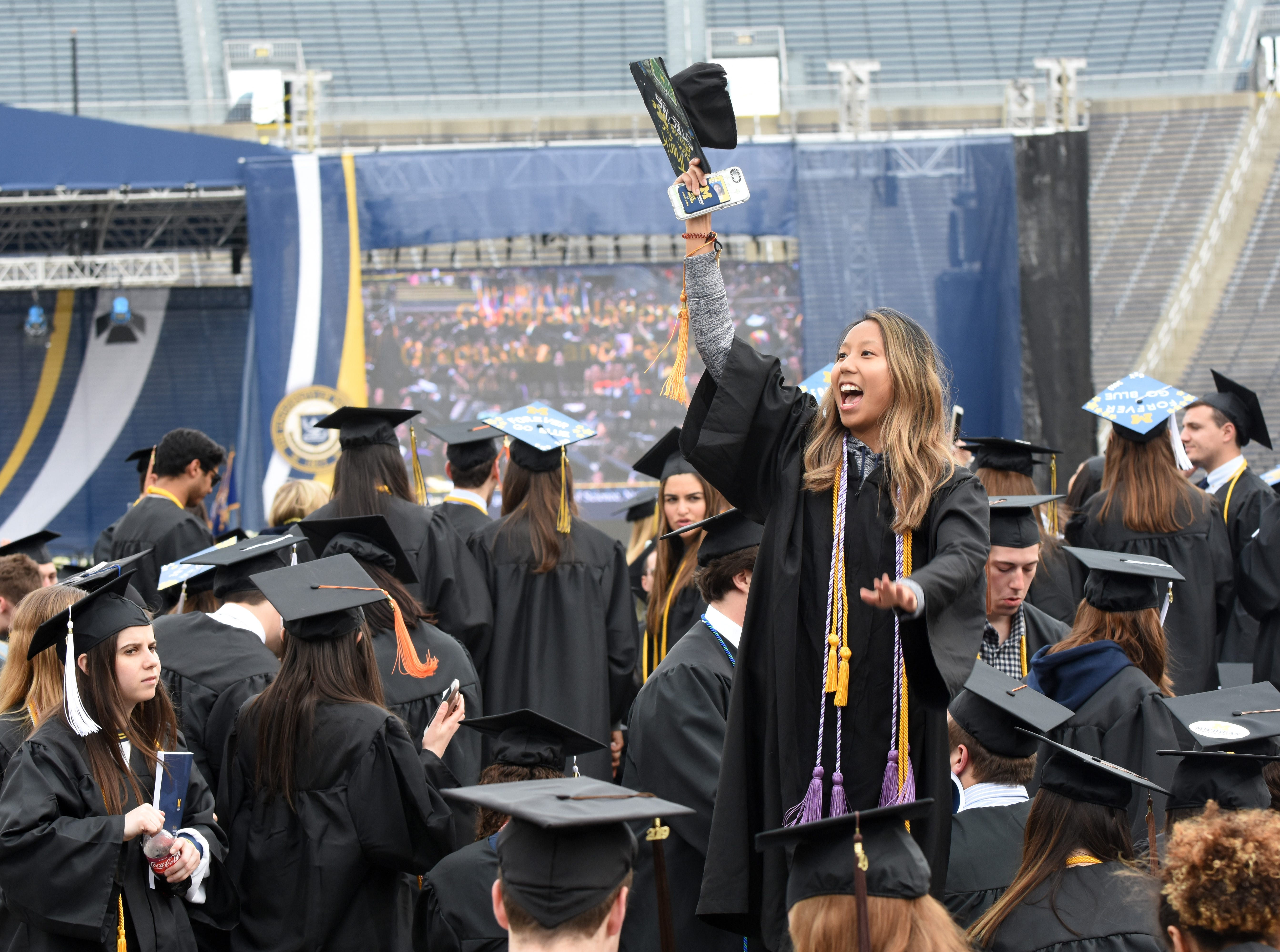 University of Michigan student Mimi Le waves to her family.