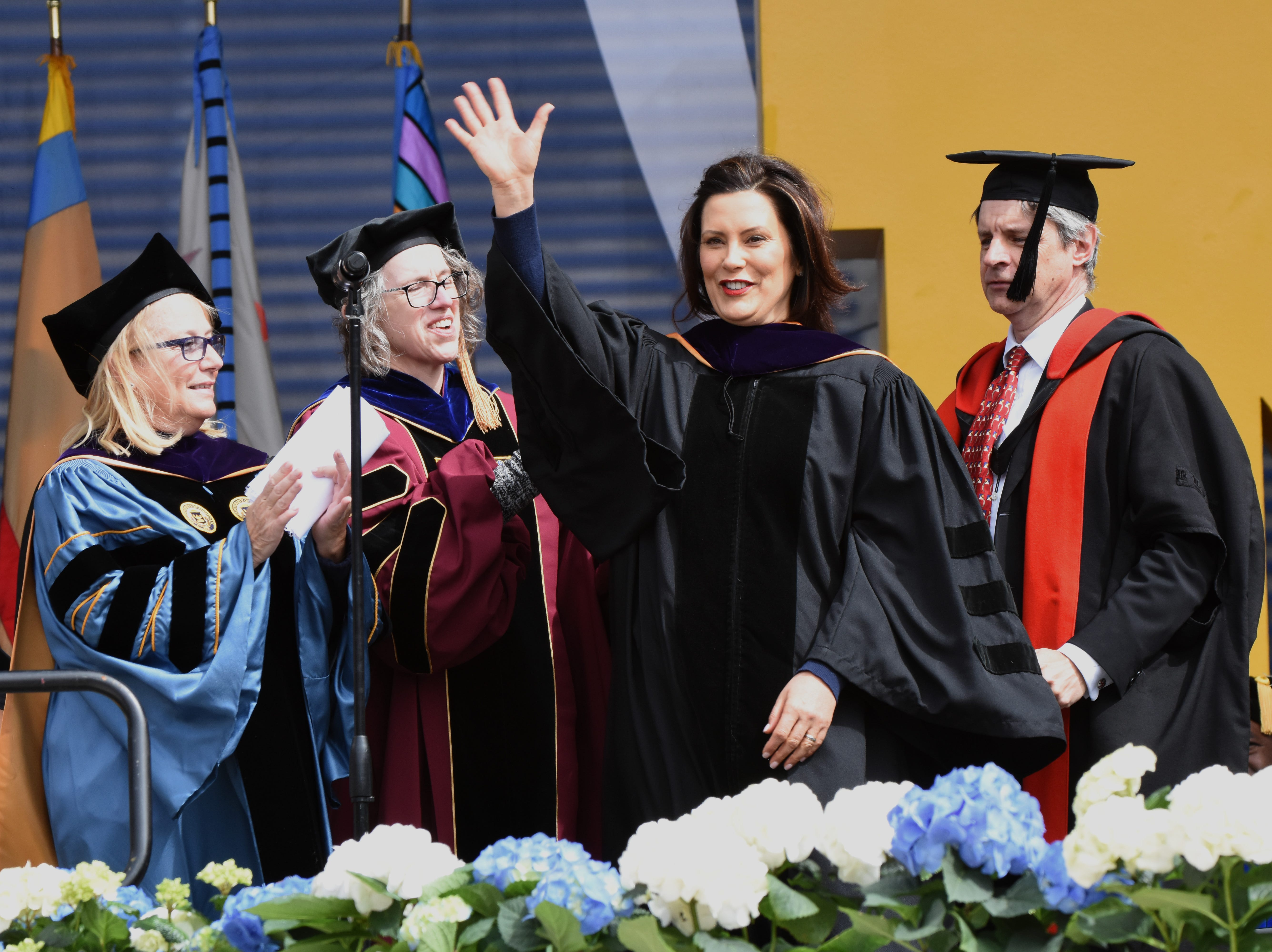 Governor Gretchen Whitmer reacts after receiving an honorary degree.