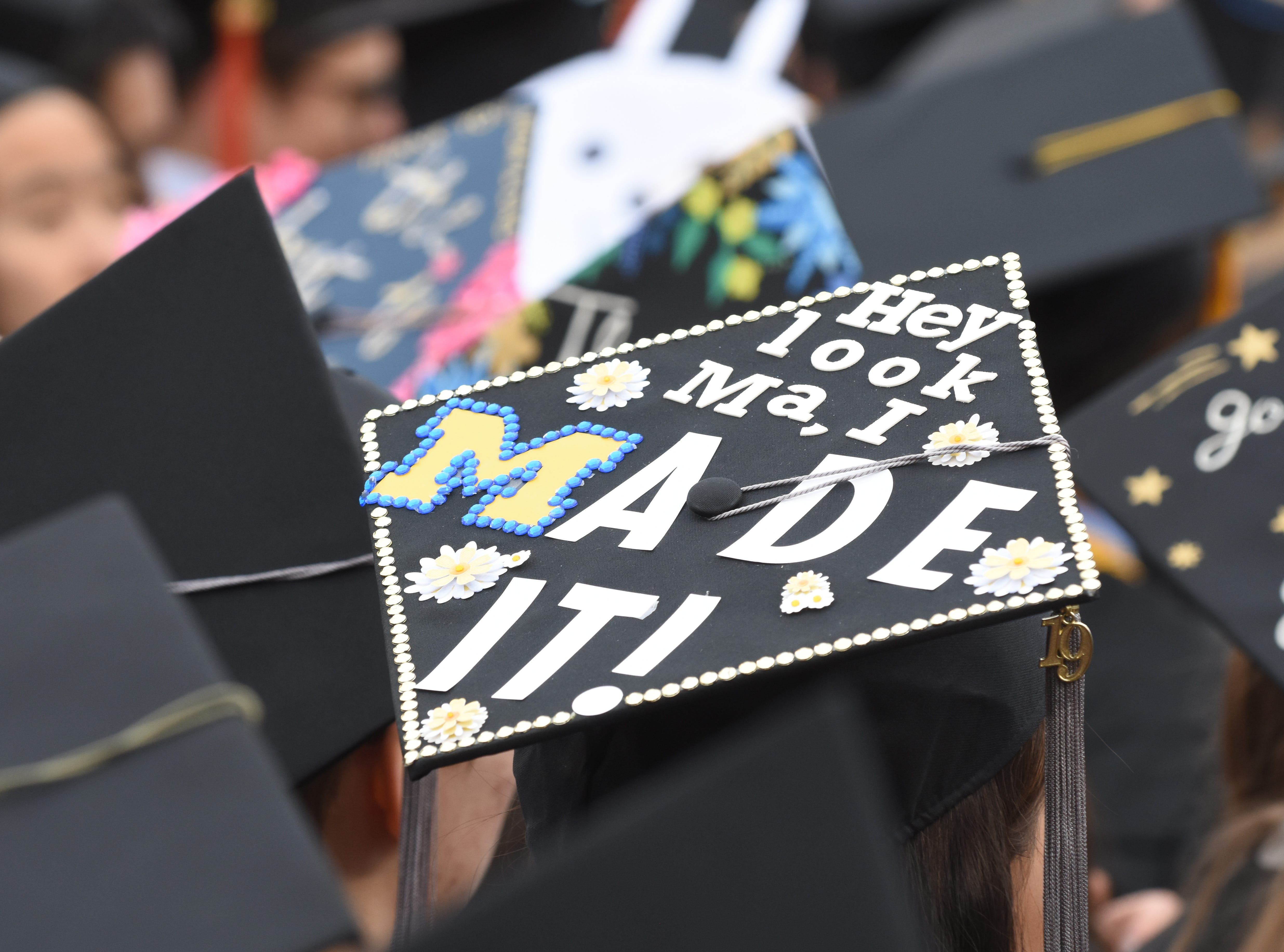 A University of Michigan student thanks her mother at commencement exercises in Ann Arbor.