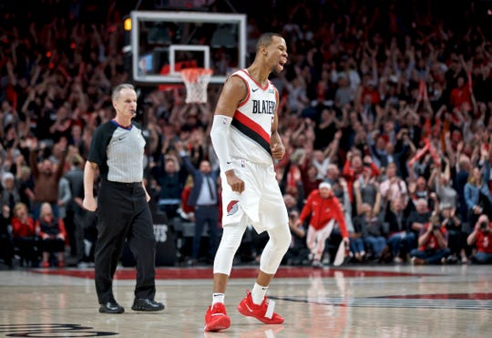 Trail Blazers guard Rodney Hood reacts after making a 3-pointer during the fourth overtime of Game 3 on Friday.