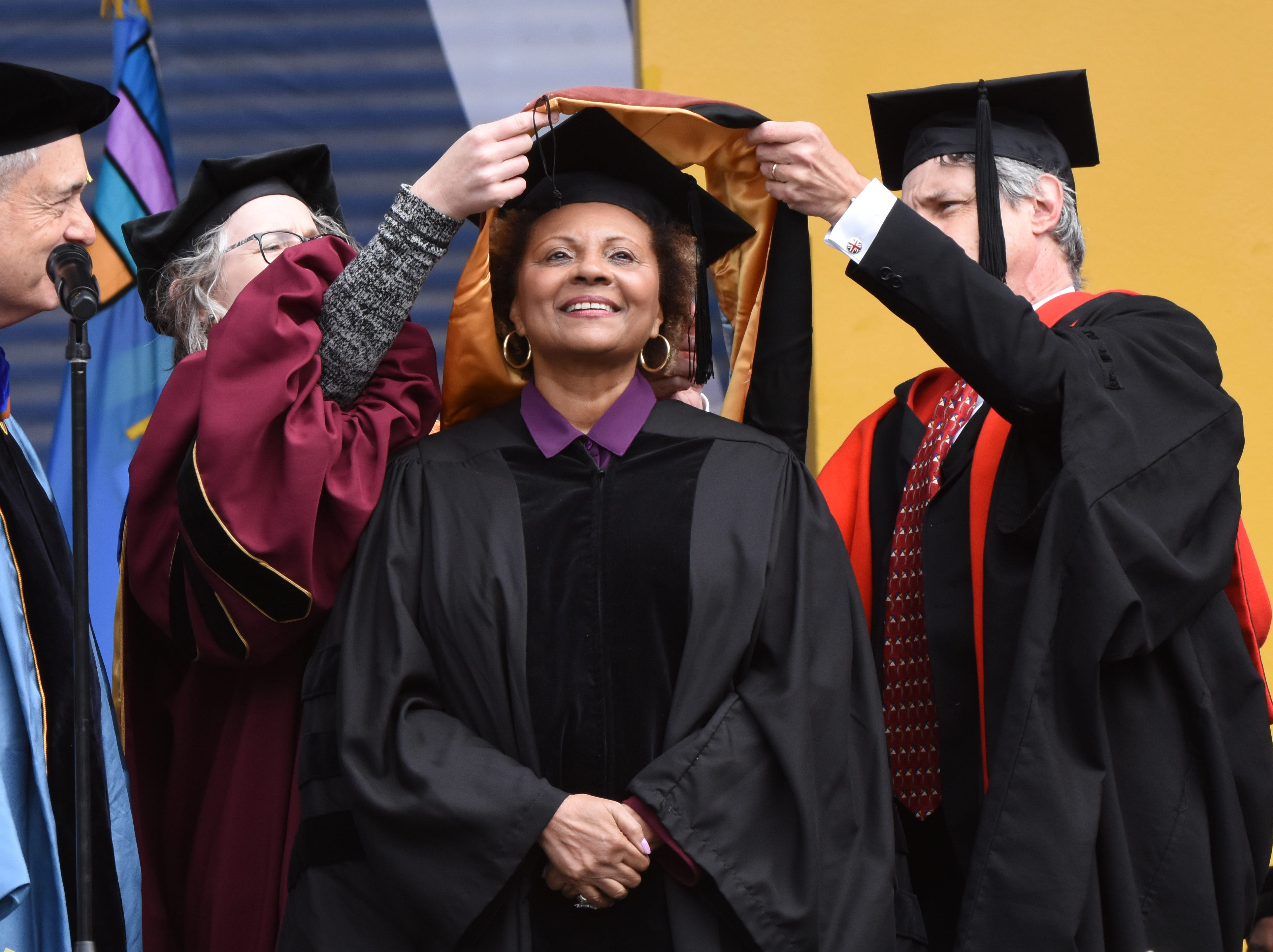 Actress Leslie Uggams receives an honorary degree during commencement exercises in Ann Arbor .