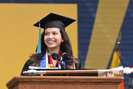 University of Michigan student Yvonne Guadalupe Navarrete speaks during UM's commencement exercise on Saturday, May 4, 2019.