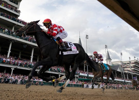 Jose Ortiz rides Serengeti Empress to victory during the 145th running of the Kentucky Oaks at Churchill Downs on Friday