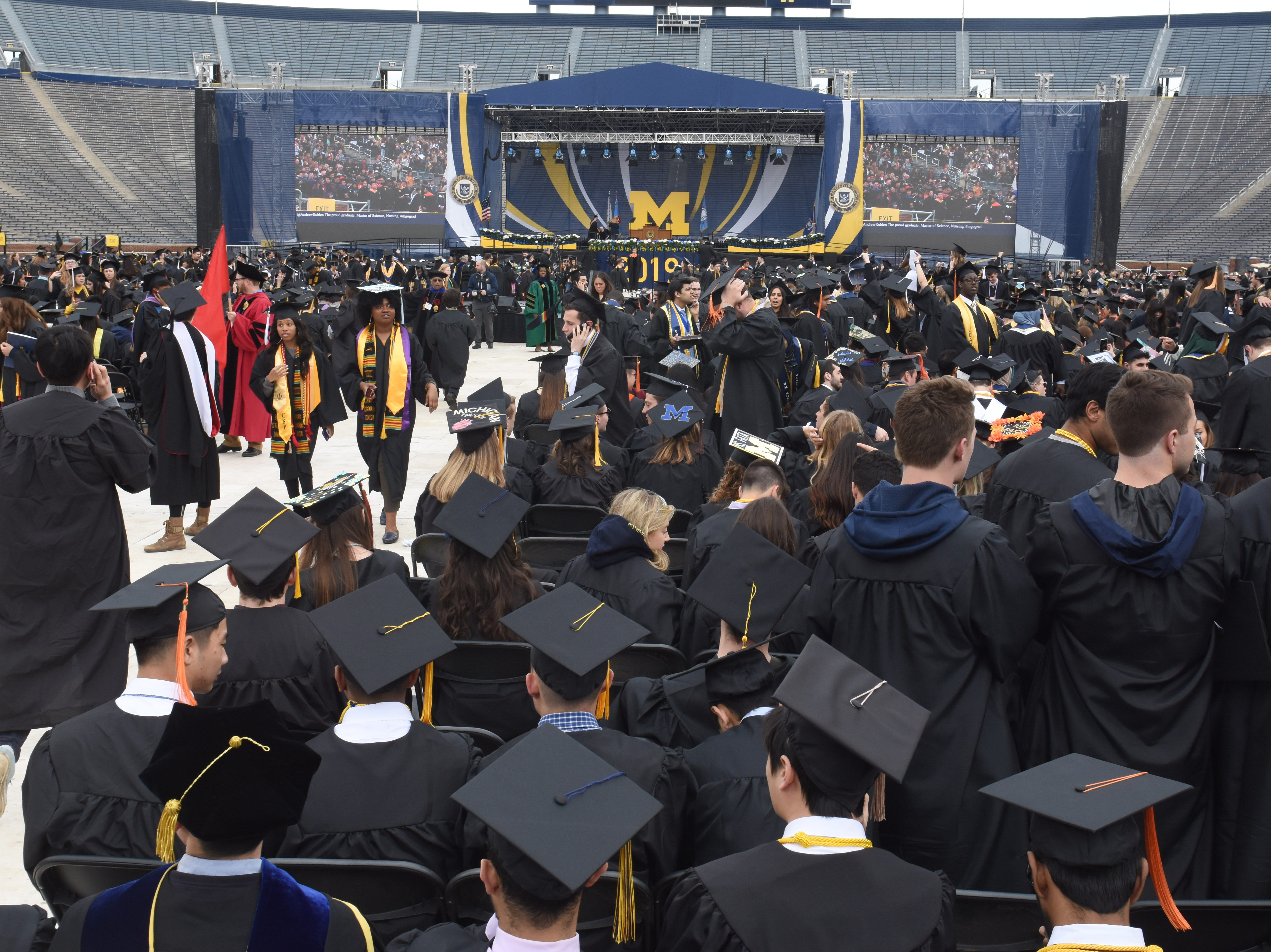 Hundreds of University of Michigan students prepare for commencement exercise.