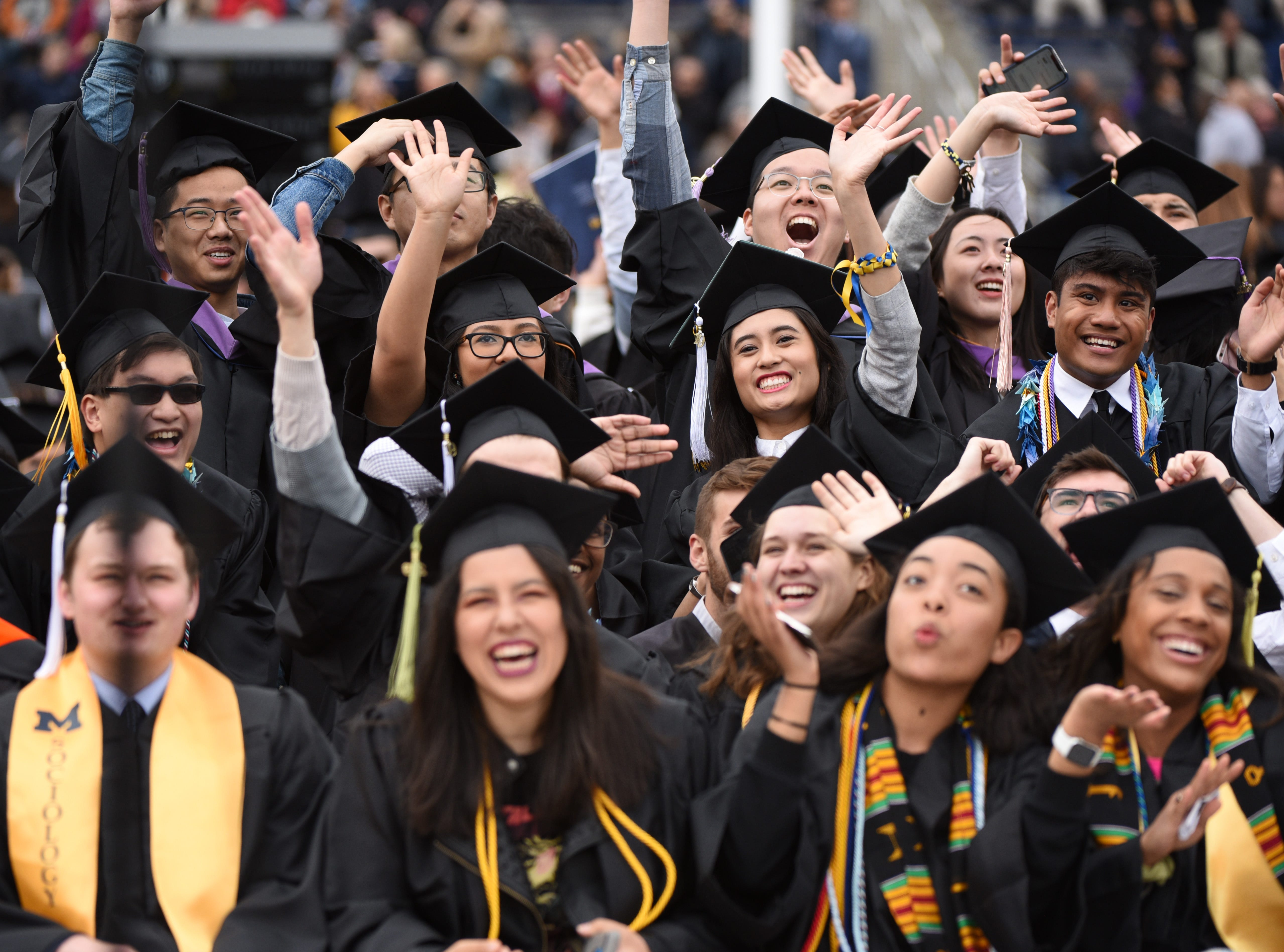 University of Michigan students celebrate during commencement.