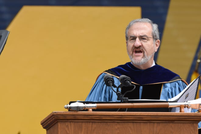 University of Michigan's President Mark Schlissel speaks to graduates during commencement on Saturday, May 4, 2019. 