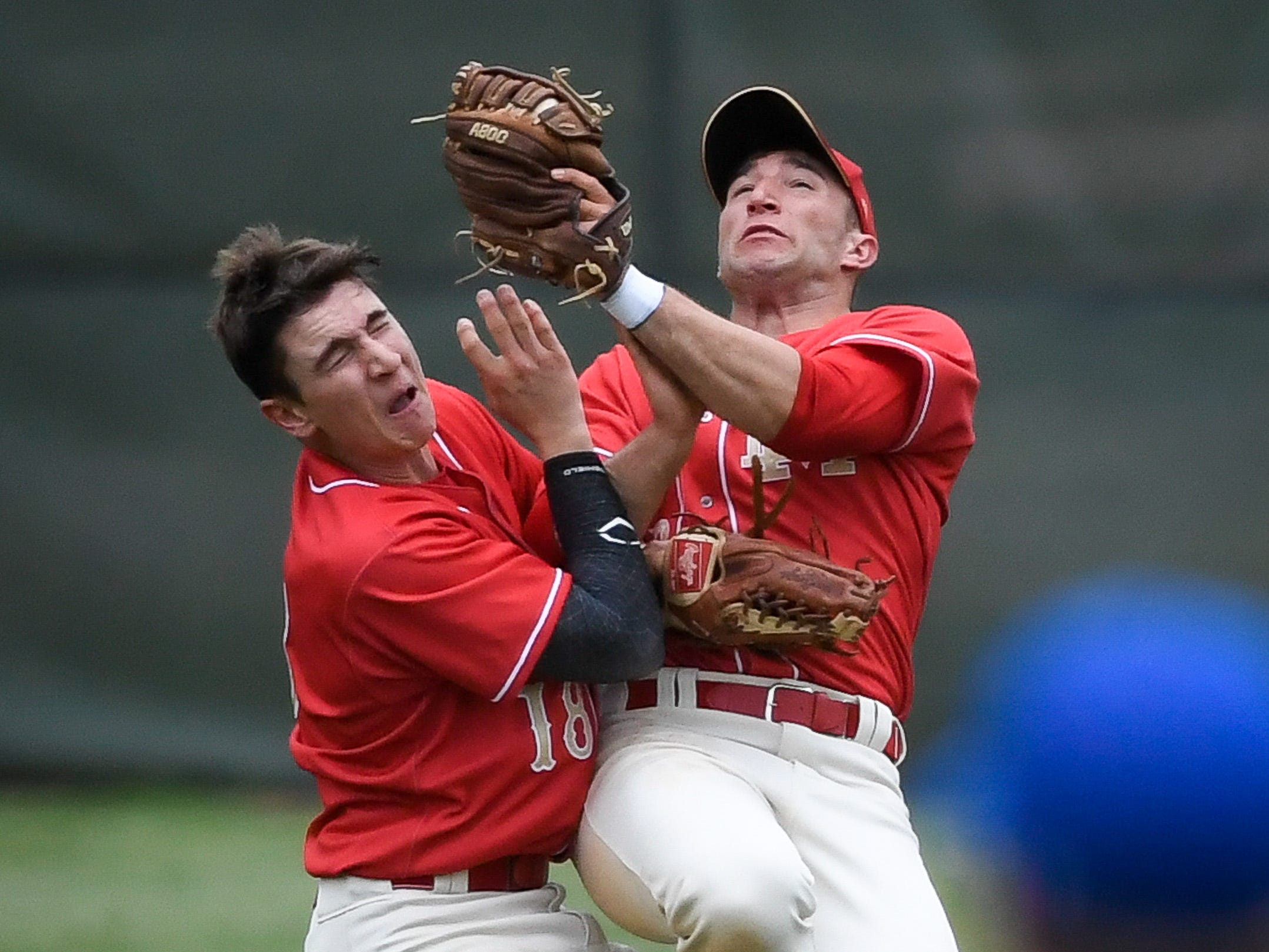 Mater Dei's Dane Babillas (18) and Hunter Taylor (22) collide after Taylor made a outfield catch as the Mater Dei Wildcats play the Memorial Tigers in a SIAC matchup at Stone Field Tuesday, April 23, 2019.
