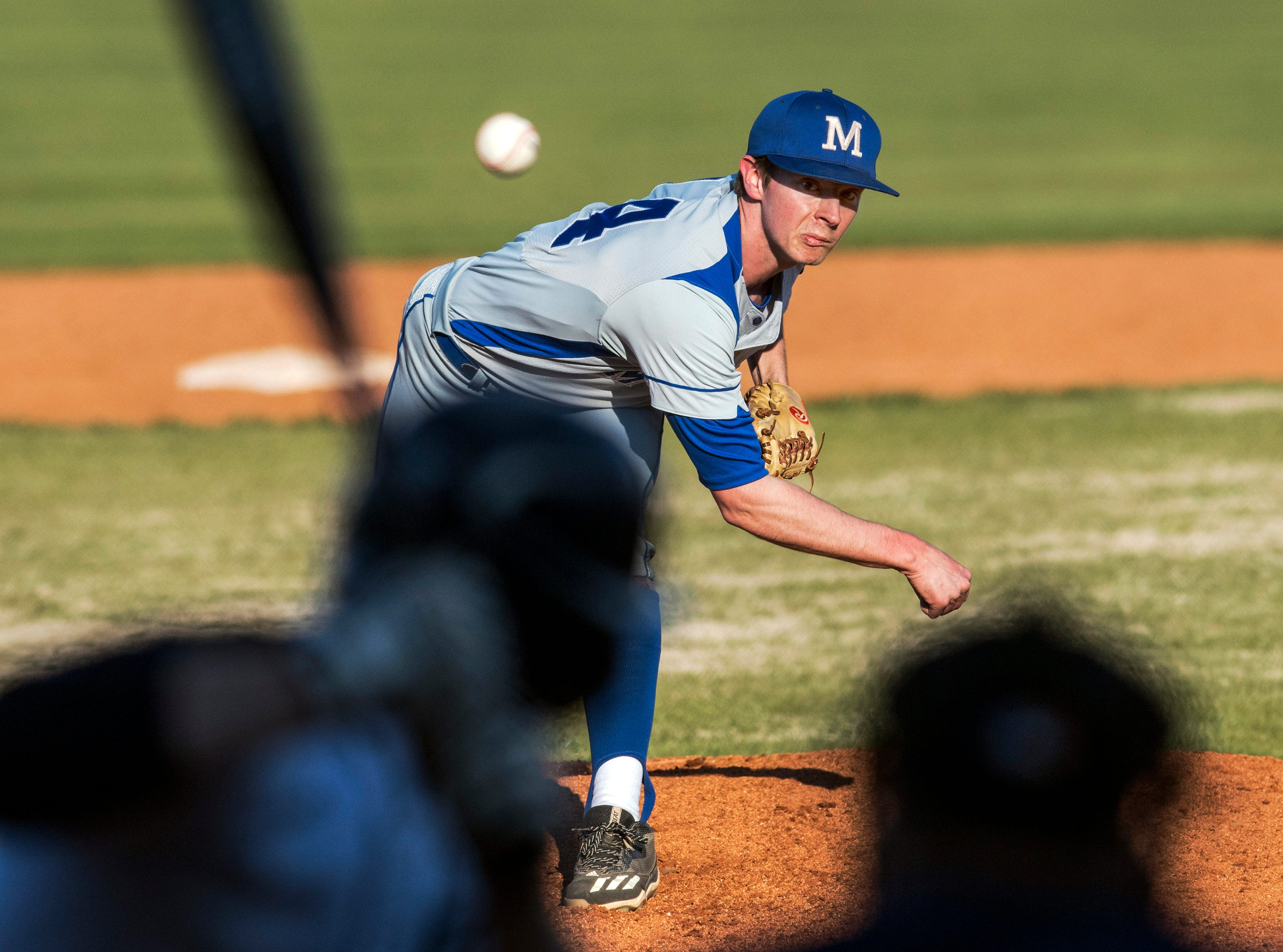 Memorial's Craig Karcher (14) pitches in the sixth inning of the Reitz Panthers vs Memorial Tigers game at Bosse Field in Evansville, Ind., Tuesday, April 2, 2019. The Memorial Tigers defeated the Reitz Panthers, 10-0.