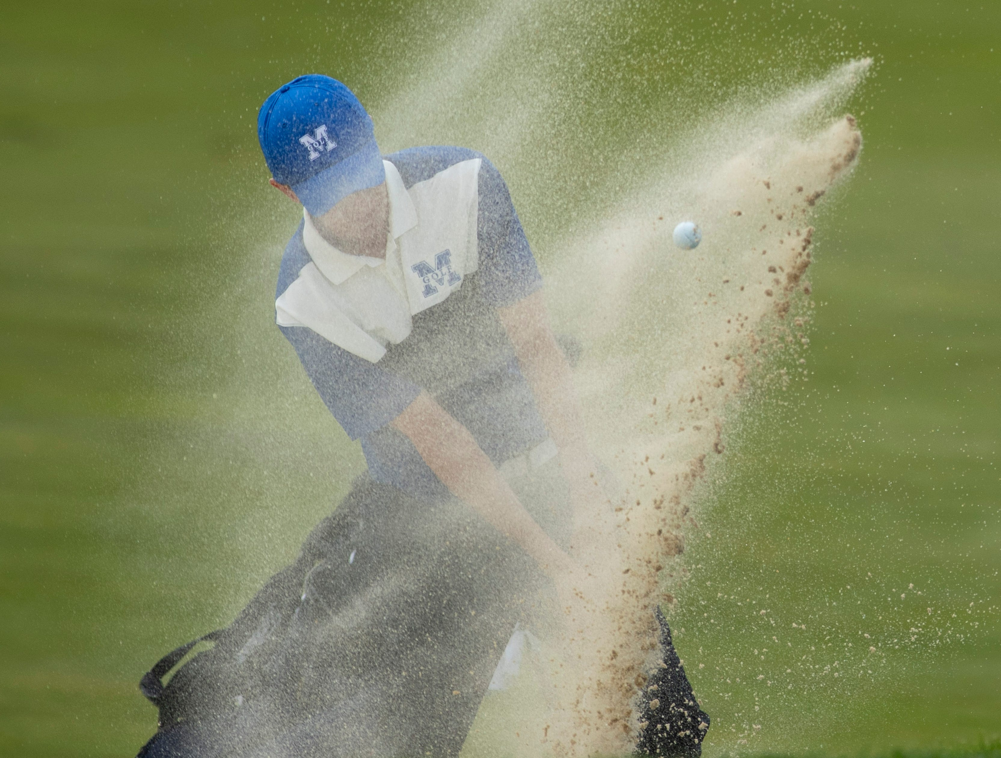 Memorial's Justin Drake hits out of the bunker at the 10th hole at Victoria National Golf Club, Saturday afternoon, April 13, 2019.