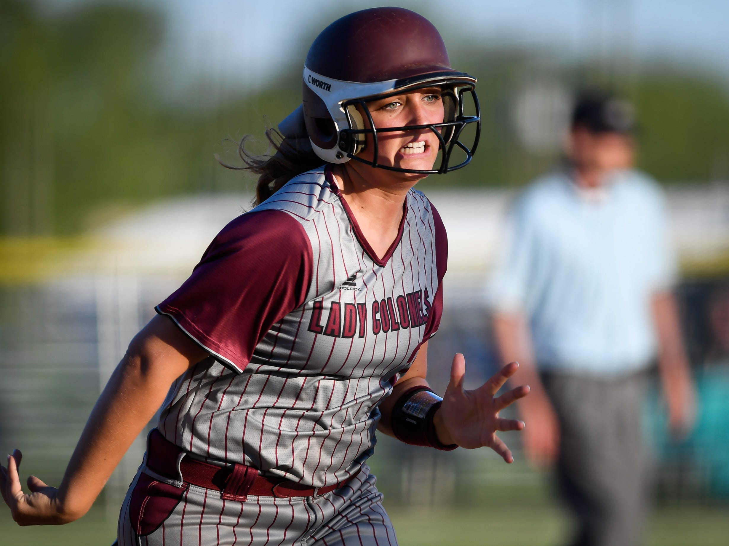 Henderson County's Hattie Hartman (27) runs down the third base line to score in the fourth inning as district rivals the Webster County Lady Trojans play the Henderson County Lady Colonels at Henderson's North Field Friday, April 26, 2019.