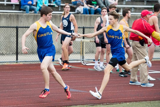 Castle's Tyler Spurling hands the baton George Economou during the SIAC boys and girls track finals at Central Stadium Friday, May 3, 2019.