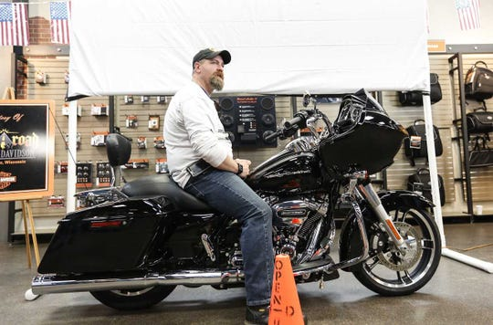 Marine Corps veteran Rob Thiede sits on his 2017 Harley-Davidson Road Glide Special Saturday at Open Road Harley-Davidson in Fond du Lac. Hogs for Heroes presented Thiede with the bike as part of the organization's mission to heal wounded veterans by equipping  them to ride with other veterans.