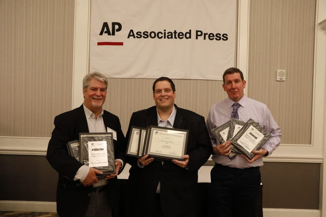 From left, News-Messenger and Port Clinton News Herald Editor David Yonke with reporters Craig Shoup and Daniel Carson at Associated Press Media Editors Awards banquet in Columbus.