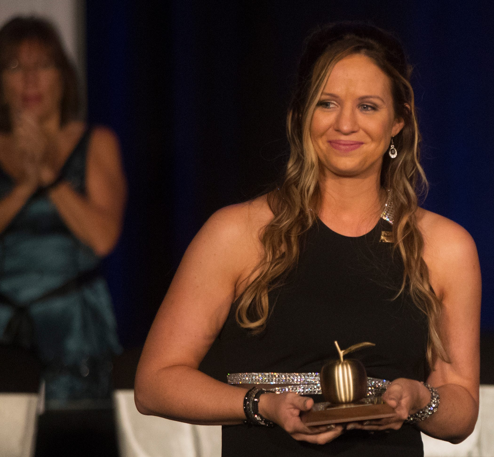 The Alva School teacher Stacey Anderson is honored on Friday at the Golden Apple Teacher Recognition Banquet at the Hyatt Regency Coconut Point in Bonita Springs.