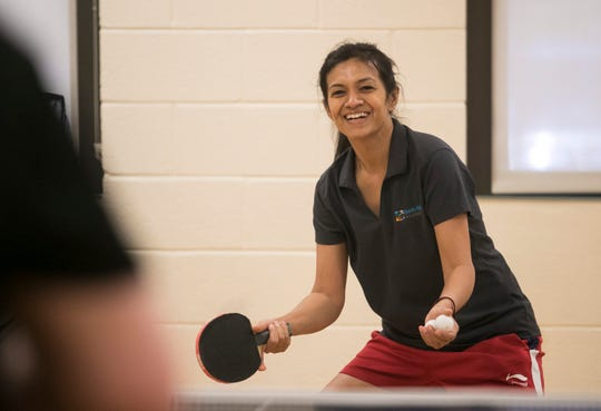 Purvi Naik teaches a table tennis class at the Estero Community Center on Saturday, April 27, 2019. The class meets twice a week.