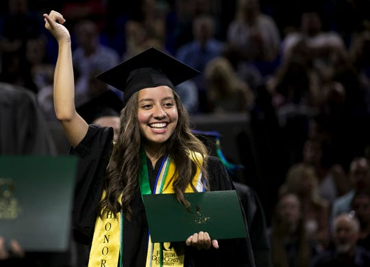 Fabiana Solano walks across the stage at her graduation from Florida Gulf Coast University on Saturday, May 4, 2019.