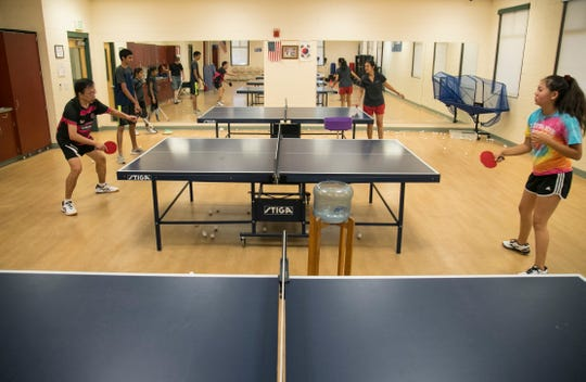 Students in a table tennis class practice at the Estero Community Center on Saturday, April 27, 2019. The class meets twice a week.