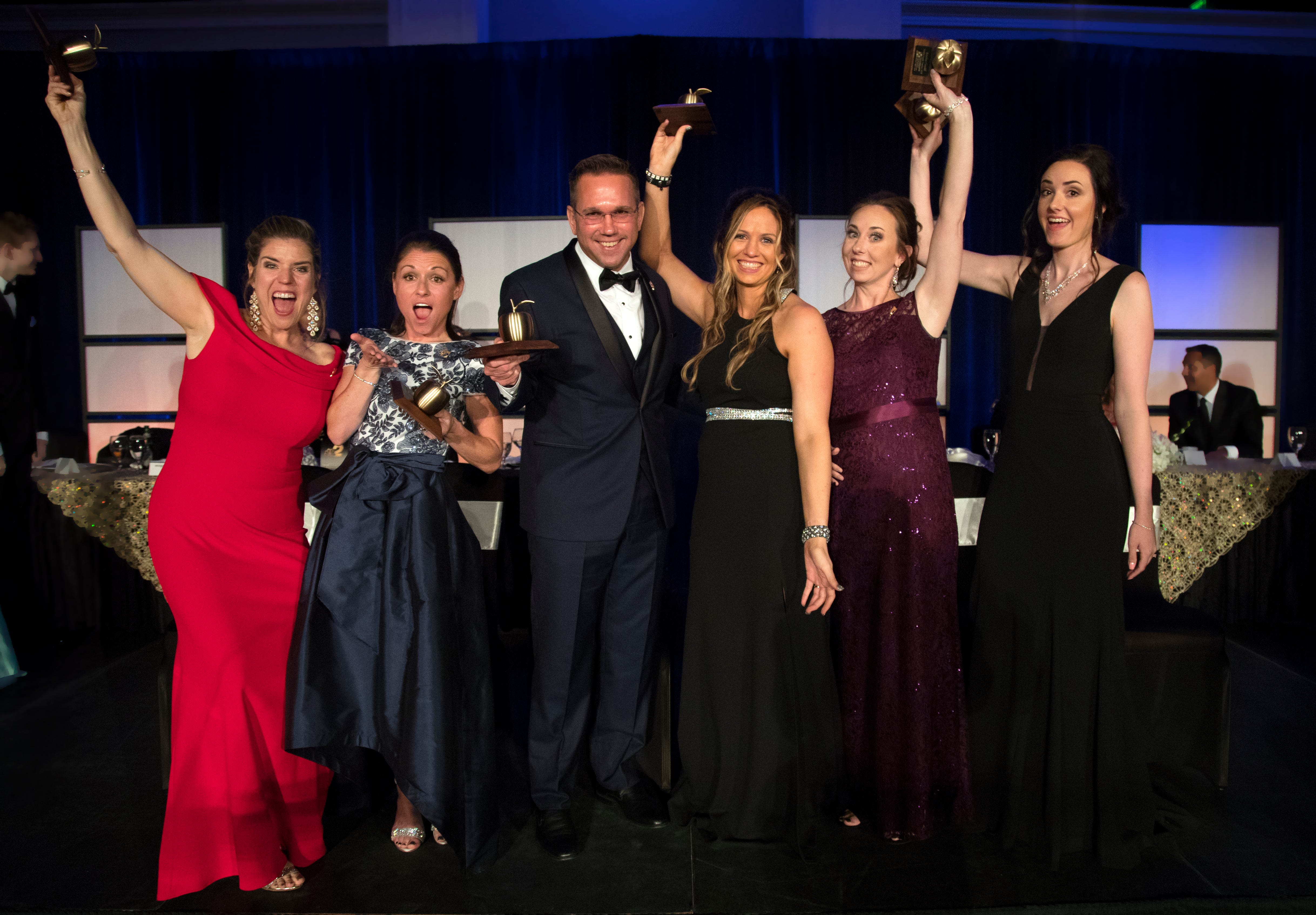 2019 Golden Apple teachers Courtney Black, left, Kristina Gale, James Rose, Stacy Anderson, Kristina Caudill and Amanda Rose are honored on Friday at the Golden Apple Teacher Recognition Banquet at the Hyatt Regency Coconut Point in Bonita Springs.