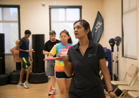 Purvi Naik leads her students in a coordination drill during her table tennis class at the Estero Community Center on Saturday, April 27, 2019. The class meets twice a week.