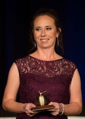 Heights Elementary School teacher Kristina Caudill is honored on Friday at the Golden Apple Teacher Recognition Banquet at the Hyatt Regency Coconut Point in Bonita Springs.
