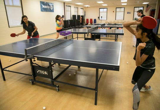 Purvi Naik, left, teaches a table tennis class at the Estero Community Center on Saturday, April 27, 2019. The class meets twice a week.