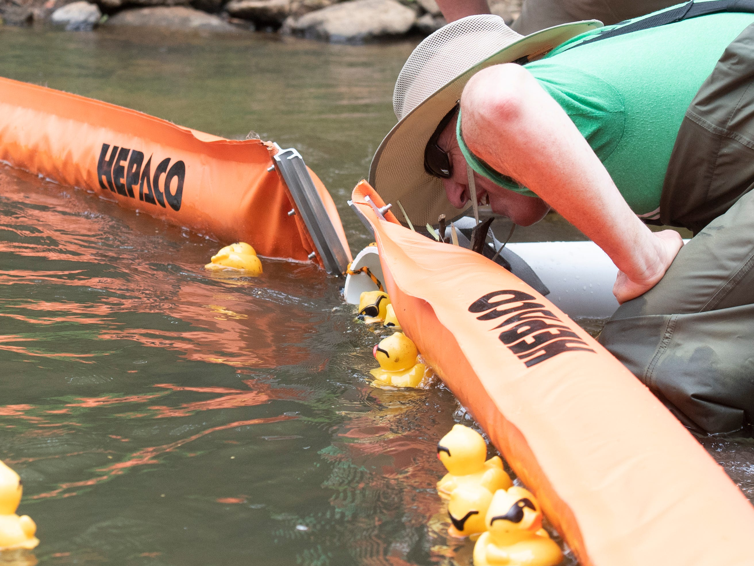Ed Calloway watches to see which rubber duck will be in first place in the 2019 Reedy River Duck Derby in Falls Park on the Reedy Saturday, May 4, 2019.