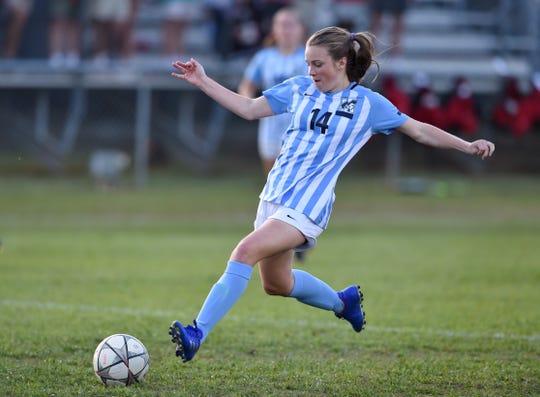 JL Mann's Anna Mussellwhite scores a first-half goal against Riverside in a Class AAAAA girls soccer playoff match on Friday.