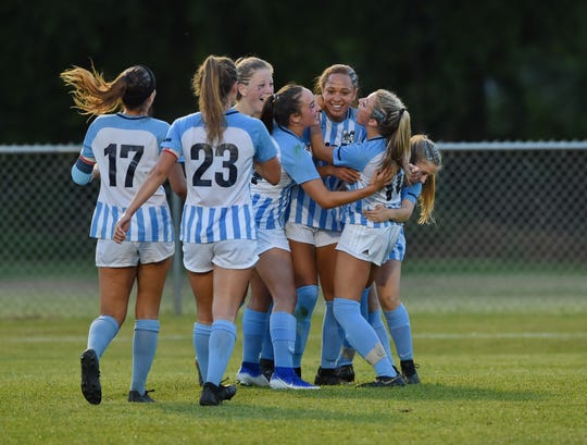 JL Mann's Calia Stanley celebrates with teammates after scoring a second-half goal against Riverside.