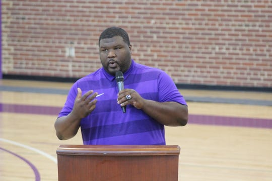 Legacy Early coach BJ Jackson introduces his players at the ceremony.