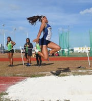 Guam High Panther Alexia Brown, 17, competes in the Women's Long Jump Varsity during a IIAAG Track and Field meet at the John F. Kennedy High School Ramsey Field in Tamuning, April 26, 2019.