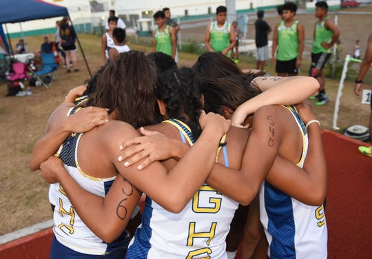 The Guam High Panthers Women's 4x100 Relay team huddles during a IIAAG Track and Field meet at the John F. Kennedy High School Ramsey Field in Tamuning, May 3, 2019.